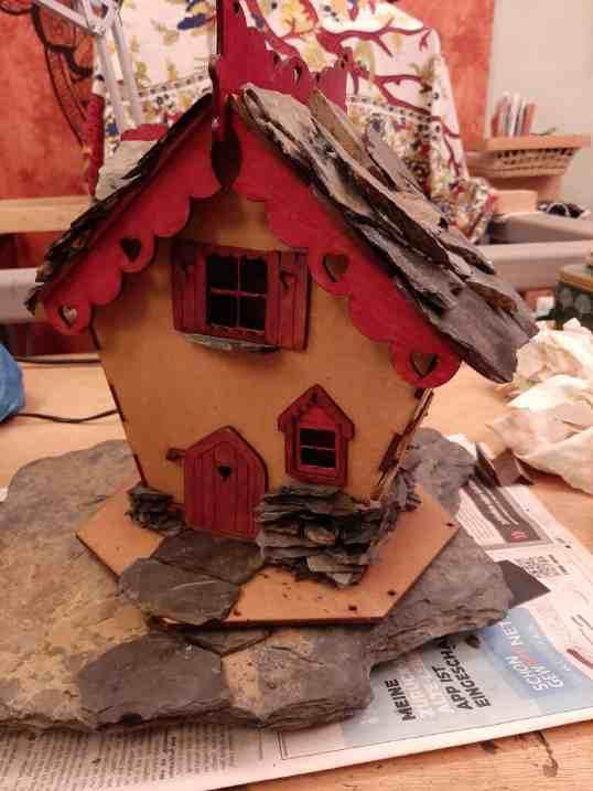 Fairy house adding rocks 2