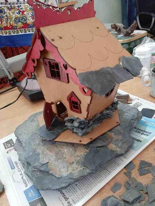 Fairy house adding rocks 1