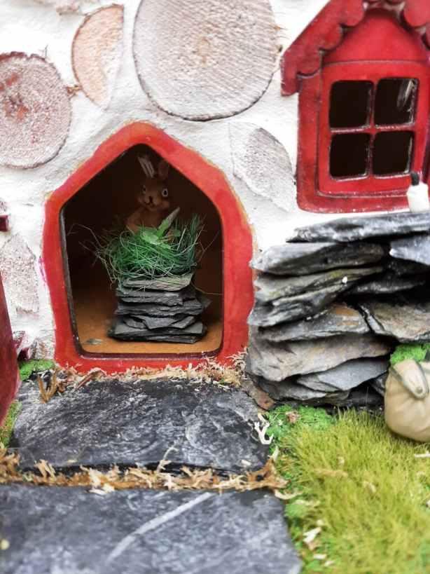 fairy house rabbit with knife
